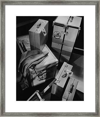 A Group Of Suitcases Ready For Travel Framed Print by Anton Bruehl