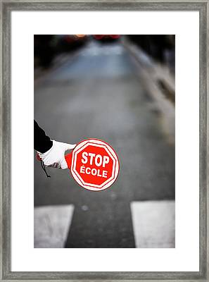 A  Hand Holding A Stop Sign In French Framed Print