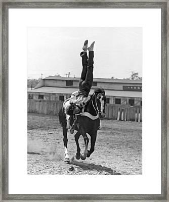 A Head Stand On Horseback Framed Print by -