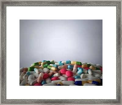 A Heap Of Medication Framed Print by Robert Brook