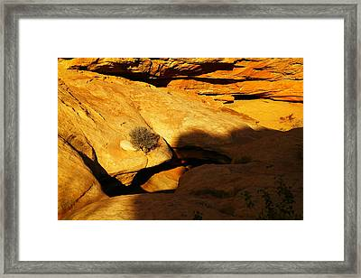 A Hole In The Rock Framed Print