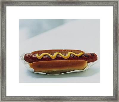 A Hot Dog With Mustard Framed Print by Romulo Yanes