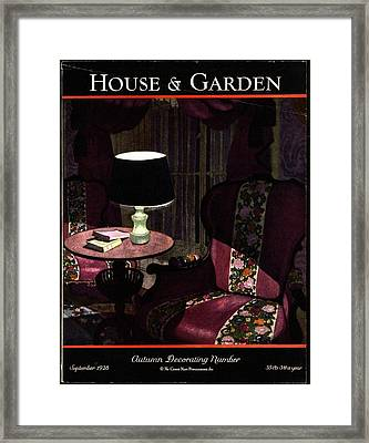 A House And Garden Cover Of A Lamp By An Armchair Framed Print