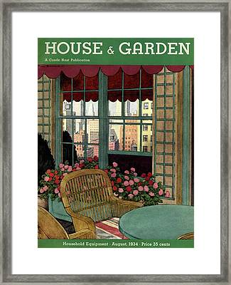 A House And Garden Cover Of A Wicker Chair Framed Print