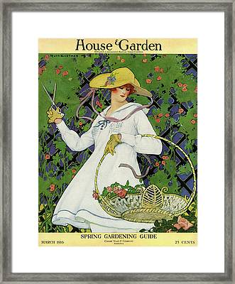 A House And Garden Cover Of A Woman Gardening Framed Print