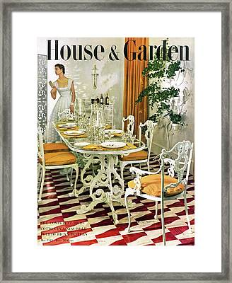 A House And Garden Cover Of A Woman In A Dining Framed Print by Horst P. Horst