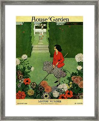 A House And Garden Cover Of A Woman Raking Leaves Framed Print by Ethel Franklin Betts Baines