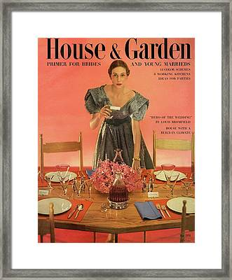 A House And Garden Cover Of A Woman Setting Framed Print by Horst P. Horst