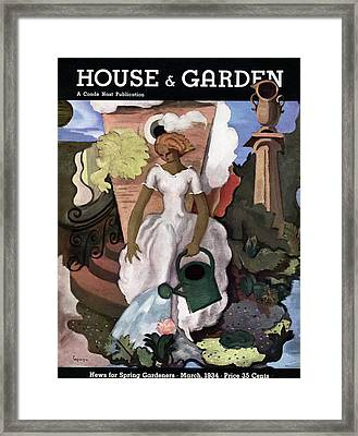A House And Garden Cover Of A Woman Watering Framed Print
