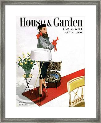 A House And Garden Cover Of A Woman With A Lamp Framed Print by Horst P. Horst