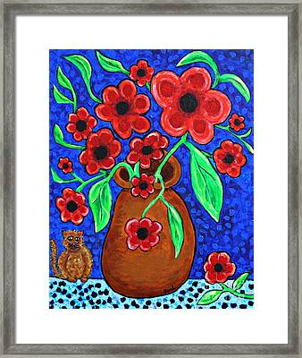 A Jug Of Red Flowers Framed Print