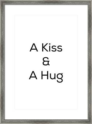 A Kiss And A Hug Framed Print by Kim Fearheiley