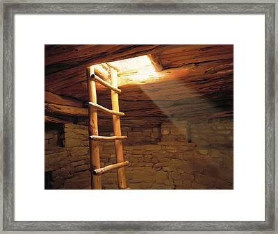 A Kiva Ladder And Sun Rays In A Kiva Framed Print