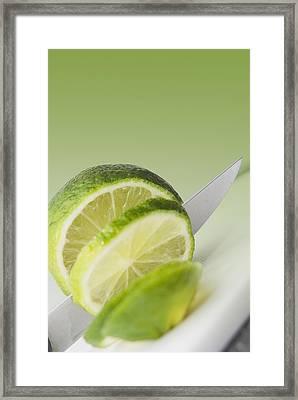A Knife Cutting A Lime Framed Print
