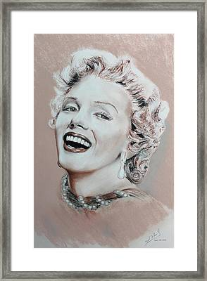 A Lady In Pink Framed Print by Miguel Rodriguez