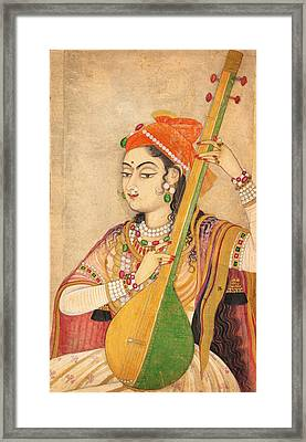 A Lady Playing The Tanpura Framed Print by Celestial Images