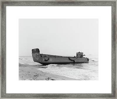 A Landing Craft Beaches To Unload Framed Print by Stocktrek Images