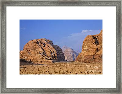 A Landscape Of Rocky Outcrops In The Desert Of Wadi Rum In Jordan Framed Print by Robert Preston