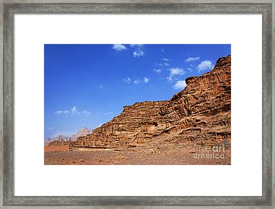 A Landscape Of Rocky Outcrops In The Desert Of Wadi Rum Jordan Framed Print by Robert Preston