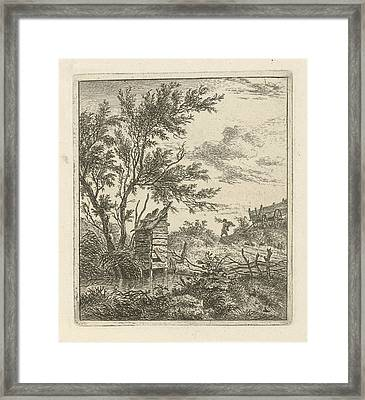 A Landscape With A Wooden Building Under A Tree By The Water Framed Print