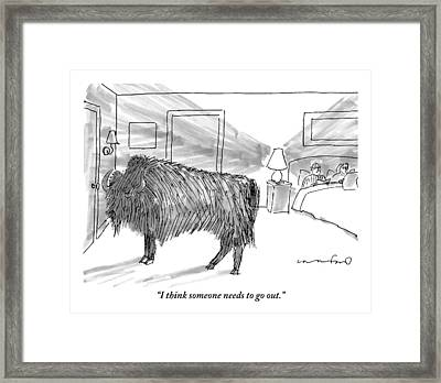 A Large Buffalo Stands Near The Door Framed Print by Michael Crawford