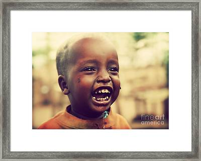 A Laughing Tanzanian Child Framed Print by Michal Bednarek