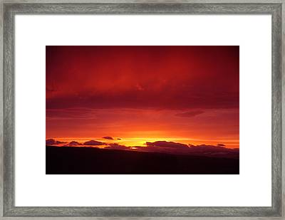 A Light In The Clouds  Framed Print by Jeff Swan