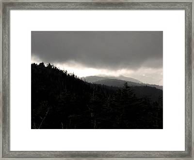 A Light In The Darkness Framed Print by Russell Clenney