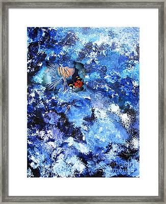 A Lion Out Of The Coral Framed Print by Gary Smith
