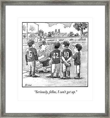 A Little-league Baseball Coach Crouches To Talk Framed Print