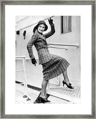 A Lively Woman Boards A Ship Framed Print by Underwood Archives