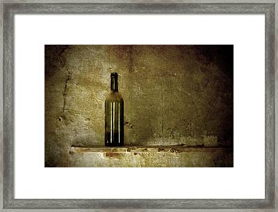 A Lonely Bottle Framed Print