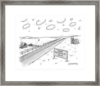 A Long, Country Road Is Pictured With A Barn Framed Print by Mick Stevens