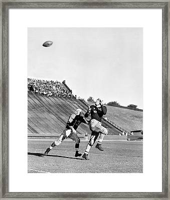 A Long Football Pass Framed Print by Underwood Archives