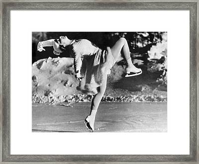 A Lovely Ballet Pose On Ice Skates Framed Print by Underwood Archives