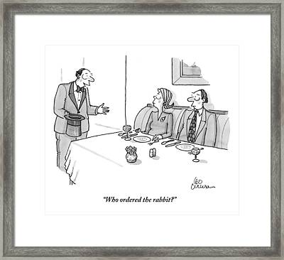 A Magician Is Seen Speaking To Two People Seated Framed Print