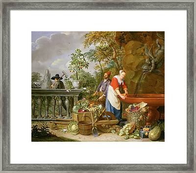 A Maid Washing Carrots At A Fountain Framed Print by Nicolaas or Nicolaes Muys