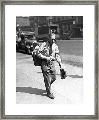 A  Mailman In The Heat Framed Print by Underwood Archives