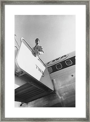 A Male Model Disembarking A Twa Boeing 707 Plane Framed Print