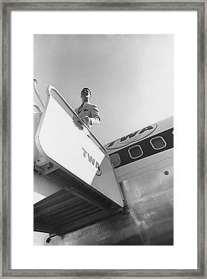 A Male Model Disembarking A Twa Boeing 707 Plane Framed Print by Leonard Nones