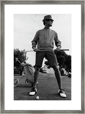 A Male Model Posing As A Golfer Wearing Framed Print by Leonard Nones