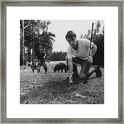 A Male Model Posing At A Golf Course Framed Print by Leonard Nones