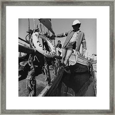 A Male Model Posing In A Boat Wearing A Cotton Framed Print by Leonard Nones