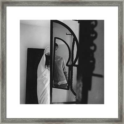 A Male Model Posing In A Mirror With A Woman Framed Print by Chadwick Hall