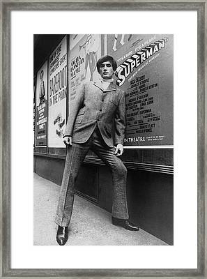 A Male Model Posing In Front Of An Advertisement Framed Print