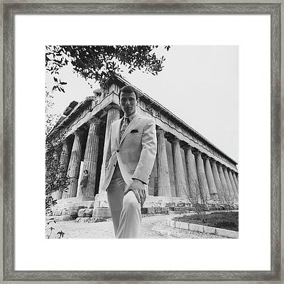 A Male Model Posing In Front Of The Theseion Framed Print