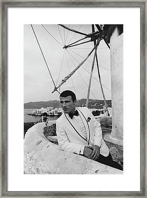 A Male Model Posing On A Terrace In Mykonos Framed Print by Leonard Nones