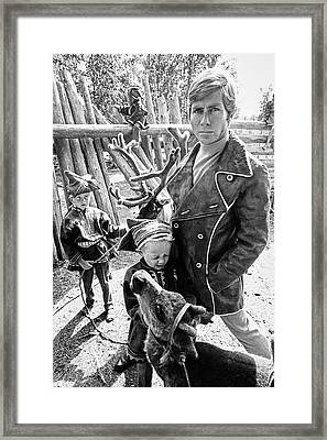 A Male Model Wearing A Coat Posing With Children Framed Print
