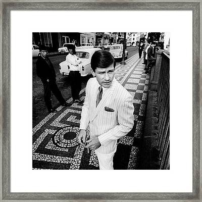 A Male Model Wearing A Suit By Ratner Framed Print by Leonard Nones