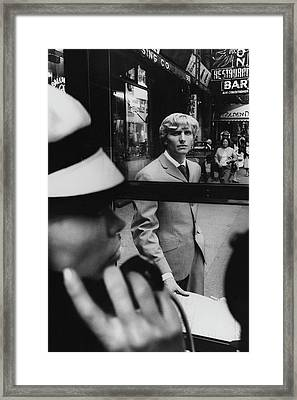 Woman In Telephone Booth Watched By Man Framed Print
